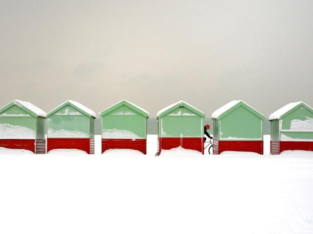 Beach huts covered in snow in Brighton and Hove, England (© Tim Jones/Alamy)