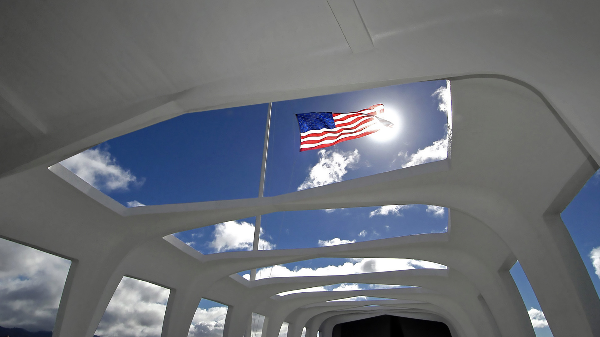 Flag above the USS Arizona Memorial in Honolulu, Hawaii (© PJF Military Collection/Alamy)(Bing United States)