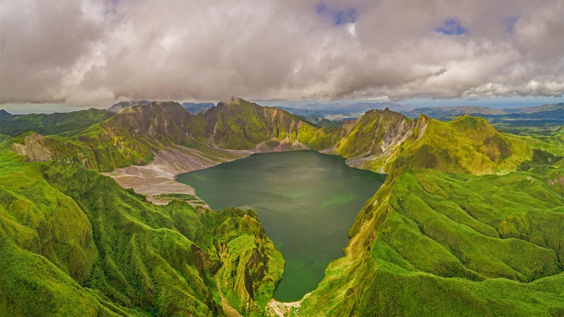 Aerial view of volcanic Lake Pinatubo and mountains, Luzon, Philippines (© Amazing Aerial Agency/Offset by Shutterstock)(Bing United States)