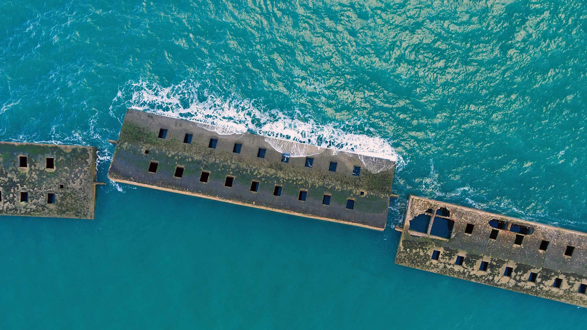 Remains of Mulberry Harbour from the D-Day invasion, Arromanches les Bains, Normandy, France (© Javier Gil/Alamy)