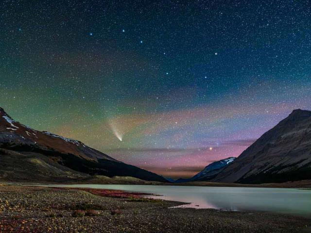Comet NEOWISE streaks across the sky over Sunwapta Lake in Jasper National Park, Alberta, Canada (© Stocktrek Images, Inc./Alamy)