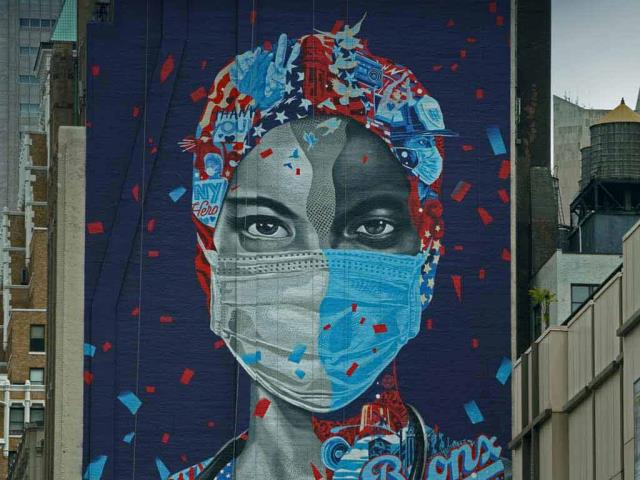 'Now & Forever,' a mural by Tristan Eaton honoring health care workers, May 11, 2020, in New York City (© Timothy A. Clary/AFP via Getty Images)