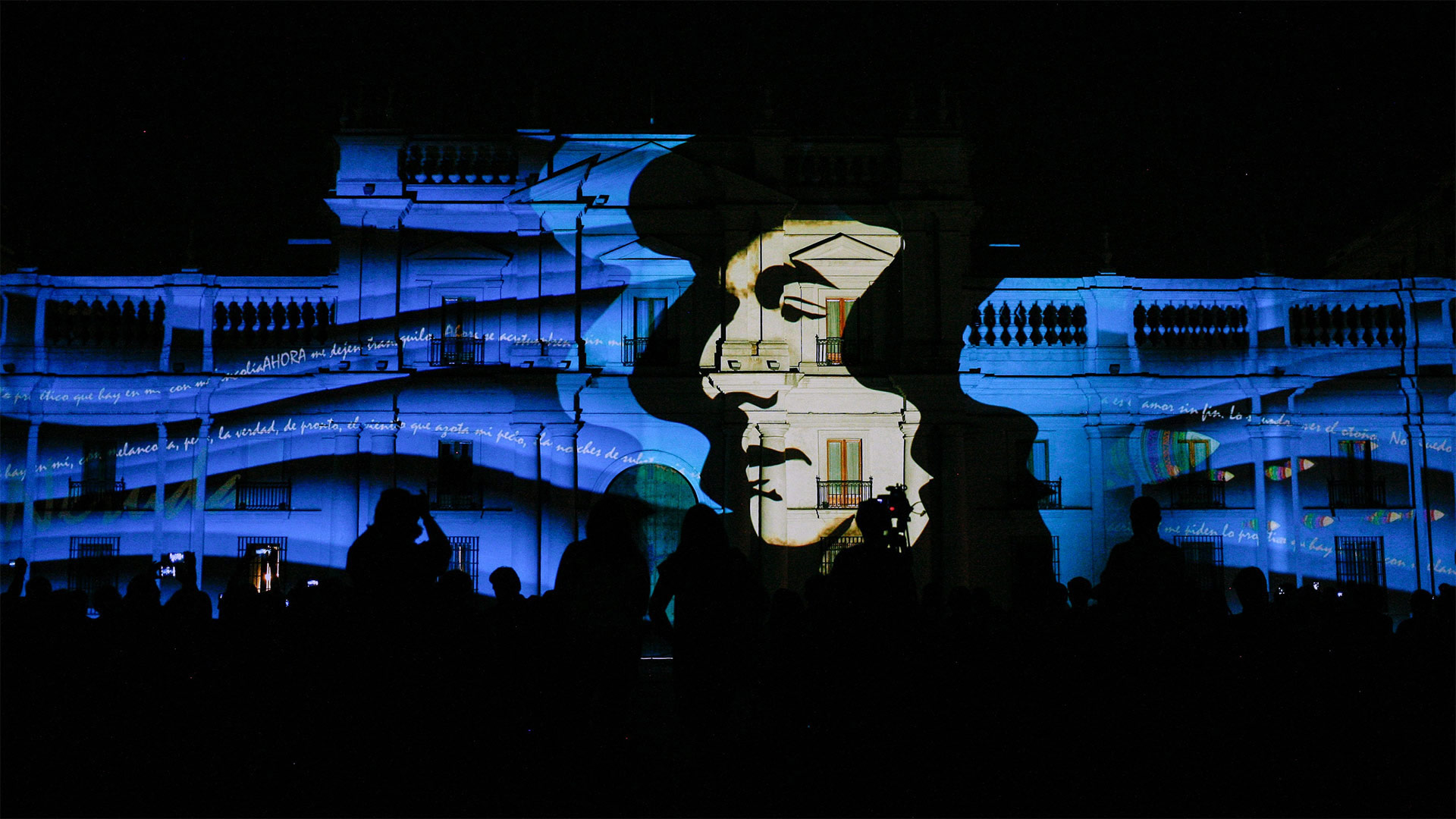 Portrait of poet Pablo Neruda projected on a building, Santiago, Chile (© Mario Tellez/Anadolu Agency/Getty Images)(Bing United States)