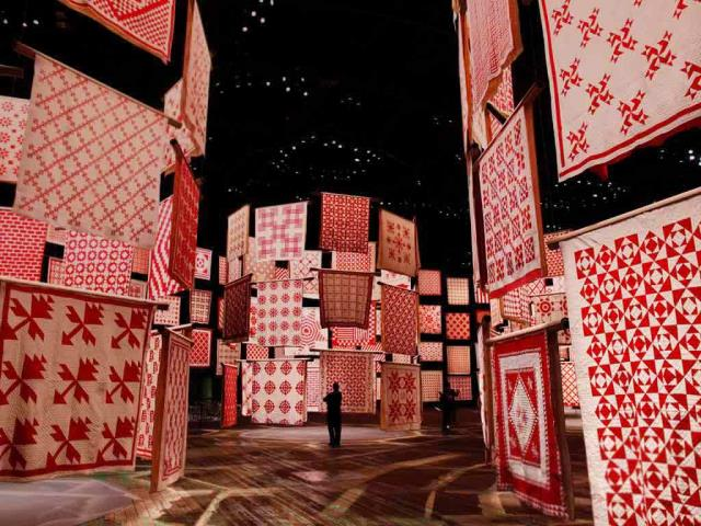 'Infinite Variety: Three Centuries of Red and White Quilts' at the American Folk Art Museum in New York City in 2011, for National Quilting Day (© Shannon Stapleton/Reuters)