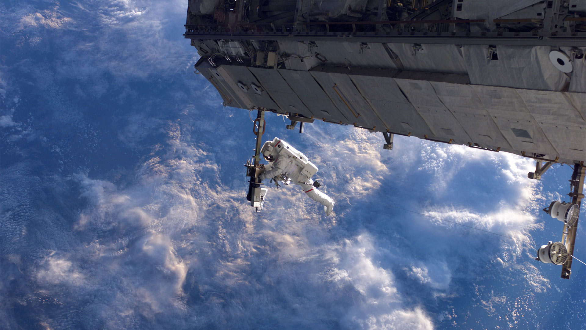 NASA astronaut works on the International Space Station during a spacewalk in 2006 (© NASA)(Bing United States)