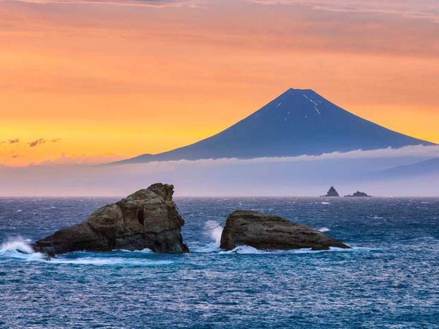 Mount Fuji and Ushitukiiwa (Twin Rocks) in Matsuzaki, Japan (© Tommy Tsutsui/Getty Images)