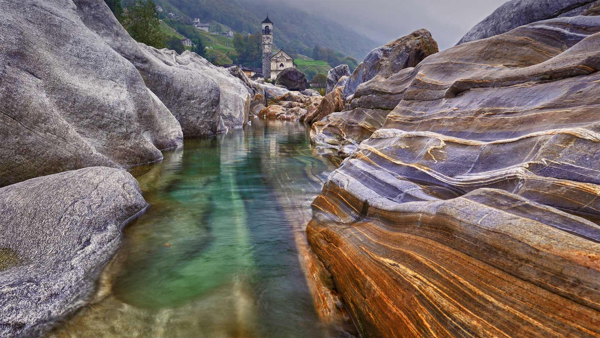Rocks in the Verzasca River near the hamlet of Lavertezzo in the Valle Verzasca of Switzerland (© Robert Seitz/Offset by Shutterstock)(Bing United States)