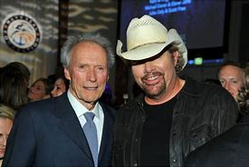 Image result for toby keith golfing with clint eastwood