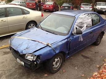Image result for image of old beat up car