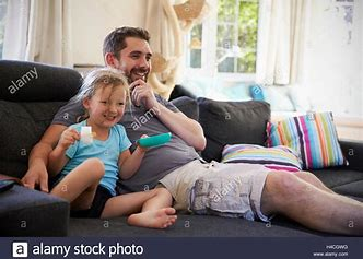 Image result for Dad and daughter watching golf on tv