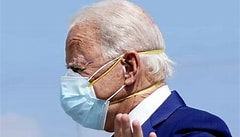 Image result for Images Biden in two masks. Size: 192 x 110. Source: www.theguardian.com