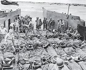 Image result for d-day deaths marked out in the sand