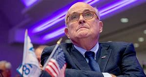 Rudy Giuliani is overhead at lunch talking about his plans for a podcast to proclaim his and the president's innocence in the impeachment scandal…