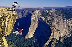 Image result for climbing a cliff