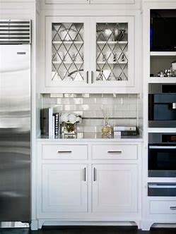 Image result for images of cabinets with glass front tops