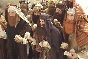 Image result for stoning scene life of brian stones heaped on man images