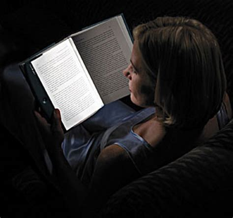 Image result for reading a book with a flashlight