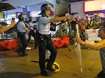 Image result for hong kong police shoot protester in stomach