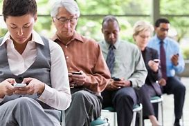Image result for people looking at cell phones at events